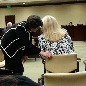 Tami Pyfer, former State Board member and Governor Herbert's new education adviser, speaks in Rep. Layton's ear
